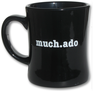 black mug with much.ado imprint